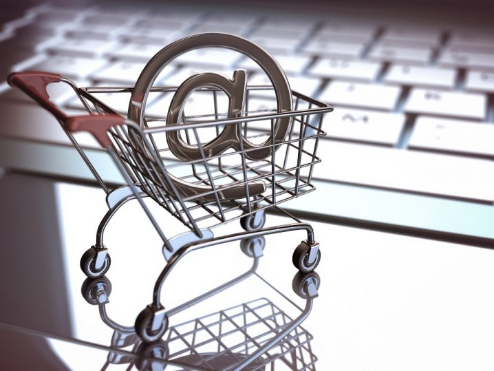 At sign, inside of the shopping cart on a laptop. E commerce concept. Depth of field with focus on At sign.
