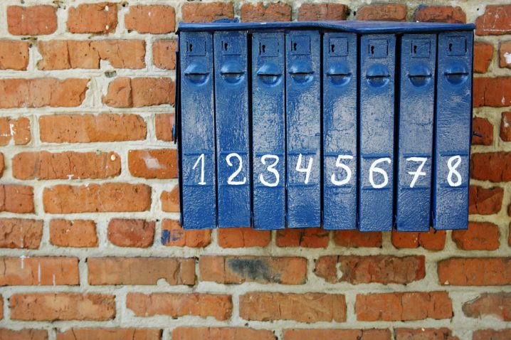 Vintage blue mailbox on a brick wall