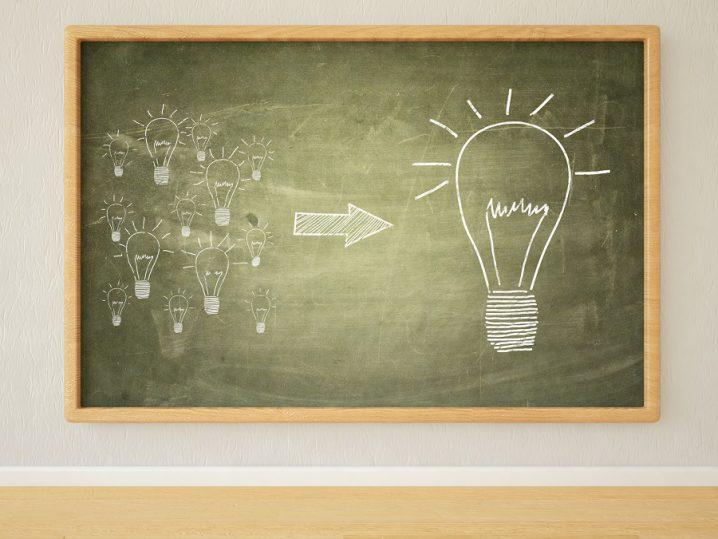 Idea - 3d render illustration of lightbulbs  on green blackboard in a room.
